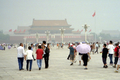 Tiananmen Square with the Tiananmen Gate in the background.  This is a large gathering place, but there is so much pollution. ... August 2, 2004 ... Copyright Robert Page III
