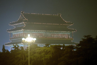 The Zhengyangmen Gate at the south end of Tiananmen Square lit up at night. Historically it used to be the main gate for the Forbidden City.  Today there is a museum inside that gives information about the history of central Beijing. ... August 2, 2004 ... Copyright Robert Page III