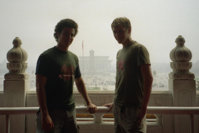 Pedro Mendoza and Rob Page on the Tiananmen Gate looking out from where Mao used to watch his military parades with Tiananmen Square in the background. ... August 2, 2004 ... Copyright Robert Page III