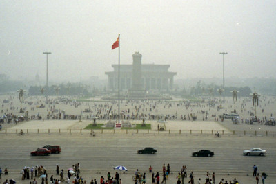 Looking out at Tiananmen Square from Tiananmen Square like Mao would, only the cars would have been tanks.  The number of people on the square is incredible. ... August 2, 2004 ... Copyright Robert Page III