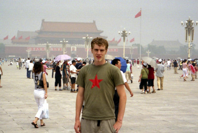 Rob Page standing in the middle of Tiananmen Square with Tiananmen Gate in the background. Photo by Pedro Mendoza. ... August 2, 2004 ... Copyright Robert Page III