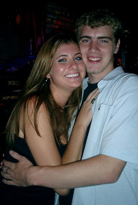 """Laura N. and Myself.  I always seem to run into her outside of the USA.  When I was in Jamaica I stayed with her and her friends at a resort in Ocho Rios.  This is at the """"Dusk Til Dawn"""" bar in Wan Chai, Hong Kong. ... July 30, 2004 ... Copyright Robert Page III"""