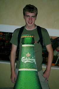 Rob Page posing behind a Carlsberg Beer cutout.  This was part of a promotion for Carlsberg Beer as they sponsored a festival that evening.  One of the representatives saw us taking photos and took a photo of Pedro as well. ... July 31, 2004 ... Copyright Robert Page III
