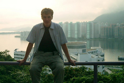 Chilling on the railing before going into the Yali Guest House at the Chinese University of Hong Kong in Shatin, Hong Kong. ... July 31, 2004 ... Copyright Robert Page III