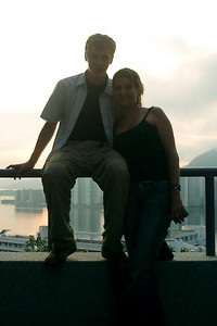 Laura N. and Myself.  I always seem to run into her outside of the USA.  When I was in Jamaica I stayed with her and her friends at a resort in Ocho Rios.  This is outside the Yali Guest House at The Chinese University of Hong Kong in Shatin, Hong Kong. ... July 30, 2004 ... Copyright Robert Page III