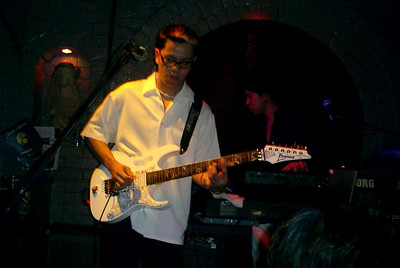 """The guitarist from the live band at """"Dusk Til Dawn."""" ... July 30, 2004 ... Copyright Robert Page III"""