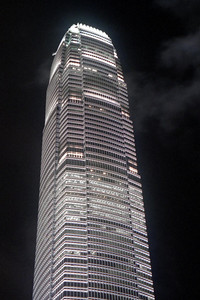 The International Financial Center (412m/1,351f, 88 floors, built in 2003) lit up at night in Hong Kong.  Photo taken from outside the Hong Kong Metro Station ... July 28, 2004 ... Copyright Robert Page III