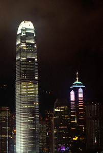 The International Financial Center (412m/1,351f, 88 floors, built in 2003) on the left and the Centre Building (346m/1,135f, 73 stories, built in 1998) on the right at night as seen from Kowloon. ... July 28, 2004 ... Copyright Robert Page III