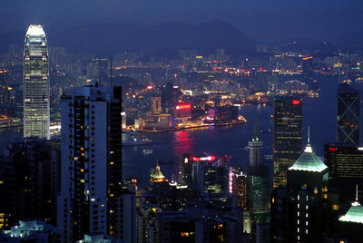 The Hong Kong Skyline with Kowloon in the background from Victoria Peak. ... July 31, 2004 ... Copyright Robert Page III
