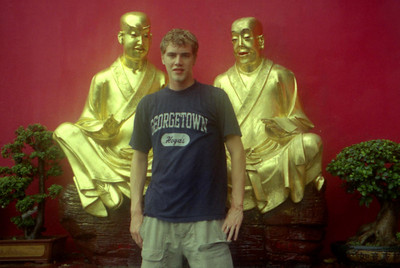 Rob Page standing in front of some of the Buddhas along the path to the Temple of 10,000 buddhas.  This is one of the most important religious site in Hong Kong and has nearly 12,000 buddhas of all sizes. Located in Shatin.  ... July 29, 2004 ... Copyright Robert Page III