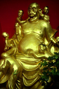 A jolly Buddha at the Temple of 10,000 Buddhas.  This is one of the most important religious site in Hong Kong and has nearly 12,000 buddhas of all sizes. Located in Shatin.  ... July 29, 2004 ... Copyright Robert Page III