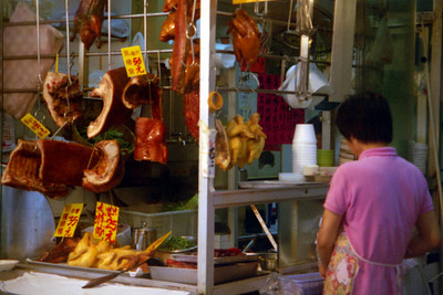A meat stall with the meat just hanging in the city air.  People would go up to the meat and feel it with their own hands to test the quality. ... July 30, 2004 ... Copyright Robert Page III