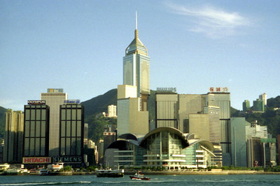 The International Convention Center in Hong Kong with the Central Plaza (374m/1,227f, 78 stories, built in 1992) rising above.  Picture from across the harbour in Kowloon. ... July 31, 2004 ... Copyright Robert Page III