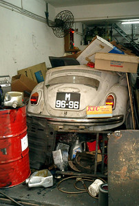 A shop that has swallowed a Volkswagon Beetle in Macau. ... July 27, 2004 ... Copyright Robert Page III