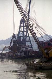 Working on the river that divides Macau from Zhuhai (China). ... July 27, 2004 ... Copyright Robert Page III