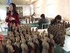 Local guide Tomi Wang Tao and Museum Staff making little warriors for sale at the Museum