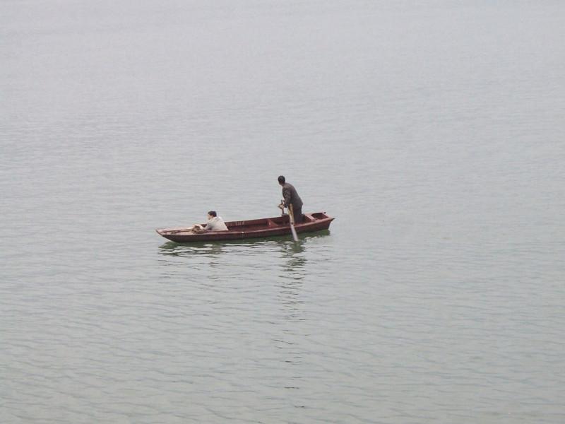 Local farmers in a small boat