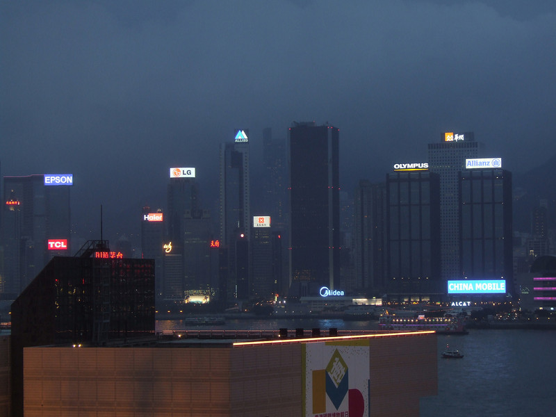 Buildings starting to light up in Hong Kong Harbor