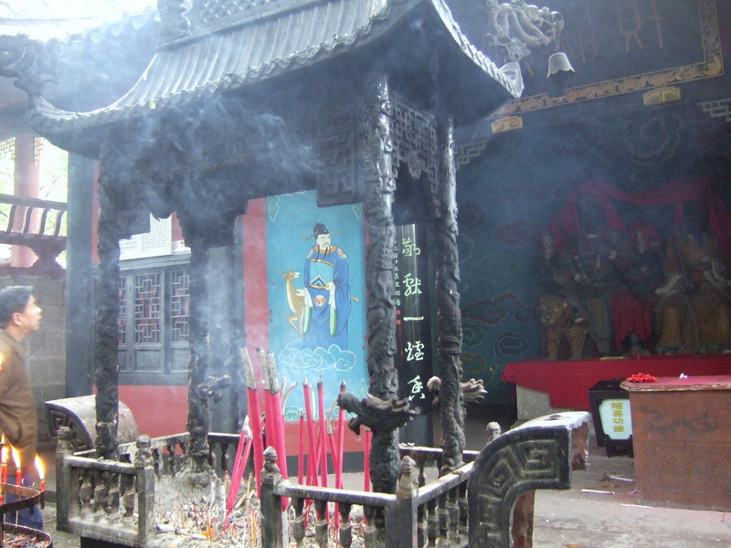 Incense smokes fill the air at the Thanks-' giving Temple