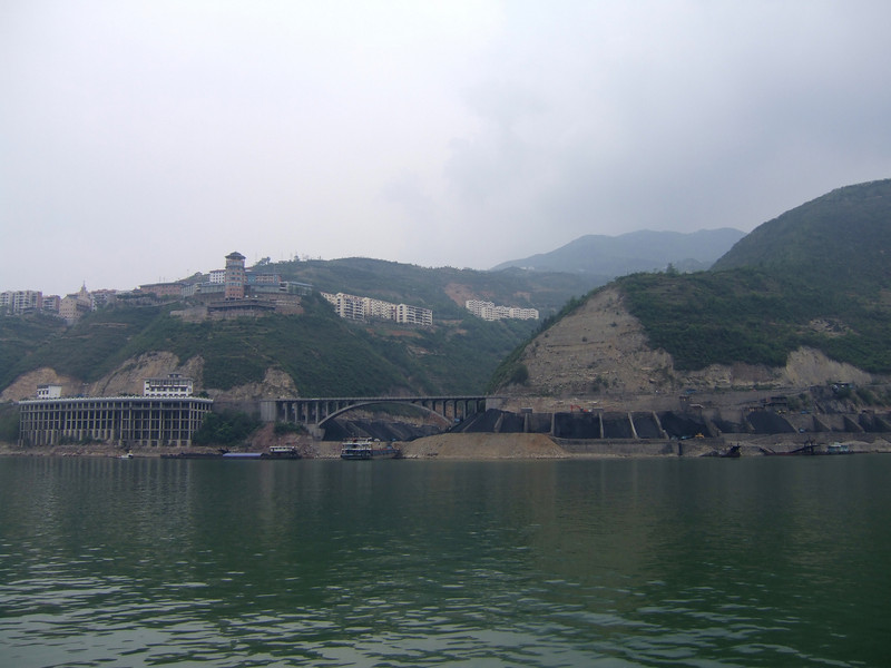 Coal plant and water front hotel with construction on the Yangtze