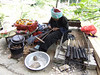 Zhuang People old lady cooking rice with meat and spice in bamboo