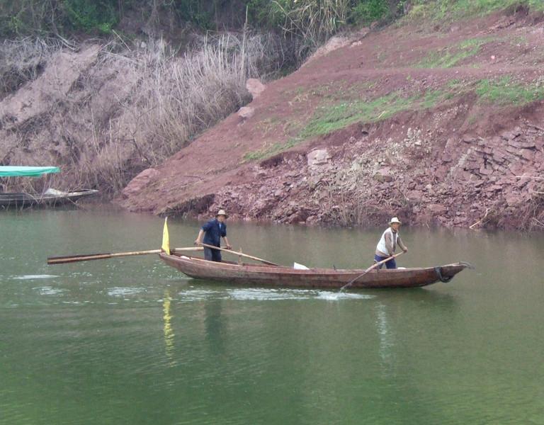 Local Farmers in a Sampan