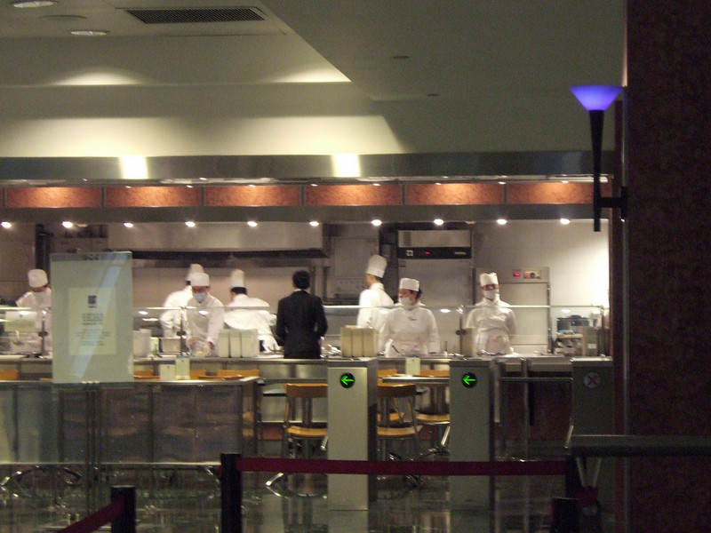 Masked food preparers in the 1,380 foot Jinmao Tower - Third Tallest in the World