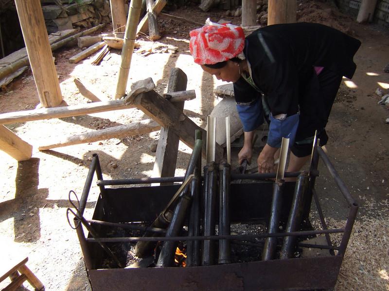 "Zhuang ""Drum"" woman preparing food"
