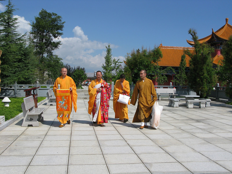 Monks on the Grounds at Three Pagodas - Dali