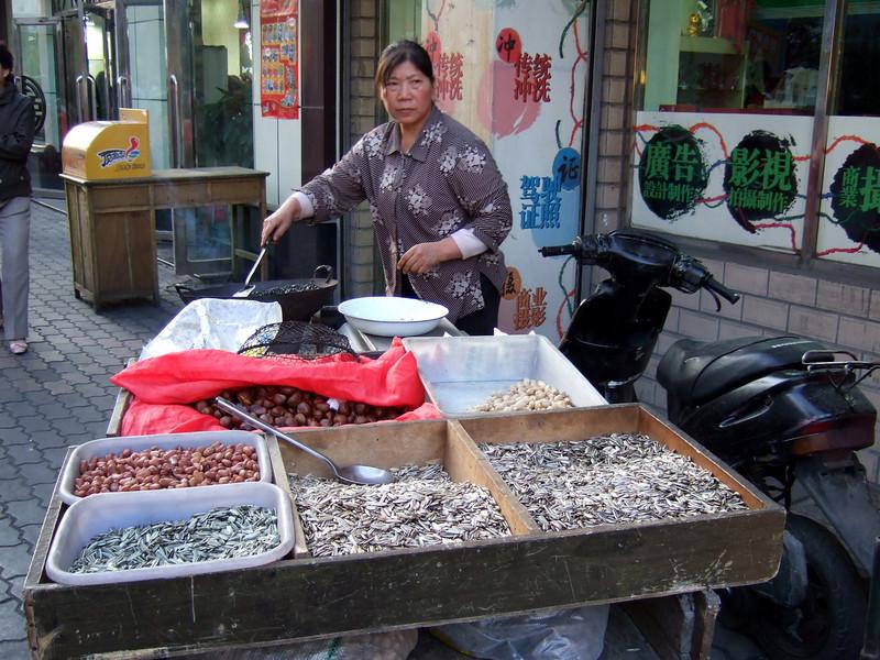 Night Market vendor setting up in Urumqi