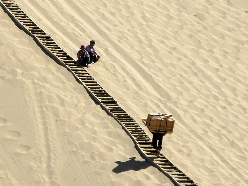 Carrying Rafts and Tubes up the Dunes