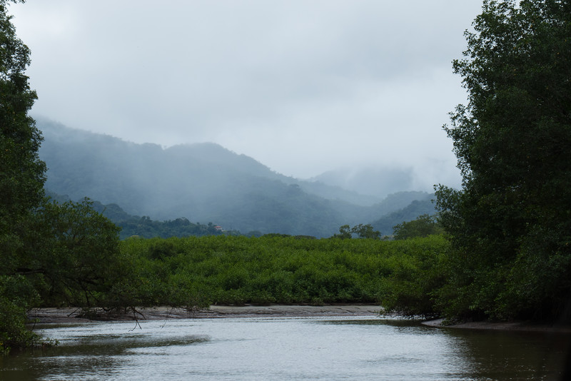 Rugged mountains in the clouds and haze near the Tarcoles River, Costa Rica.