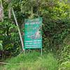 Jungle Crocodile Safari advertisement on the bank of the Tarcoles River in Costa Rica.