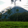 Volcano Arenal almost fully clear of cloud cover from the Baldi Hot Springs Park.