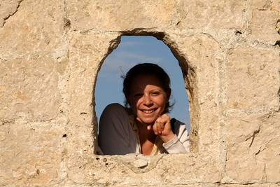 Emily looks through an old window - Korcula, Croatia ... May 2, 2008 ... Photo by Rob Page III