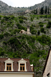 The city walls and a church look over the town of Kotor - Kotor, Montenegro ... April 30, 2008 ... Photo by Rob Page III