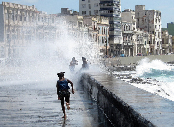 Havana is on a big bay, and one hot day the waves came crashing into walkway along the bay.  The kids took advantage.