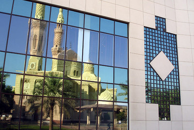 The the Jumeirah Mosque reflects off its neighbor's windows - Dubai, UAE ... November 19, 2006 ... Photo by Rob Page III