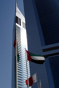 The Emirates Towers with the United Arab Emirates flag waving in the foreground - Dubai, UAE ... November 19, 2006 ... Photo by Emily Conger