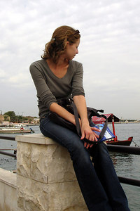 Emily sitting along the banks of the Dubai Creek - Dubai, UAE ... December 1, 2006 ... Photo by Rob Page III