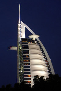 The Burj Al Arab.  This is the iconic building of Dubai and just opened in 1999.  It is a self proclaimed 7 star hotel built on its own island.  It rises 1,053 feet (321 meters) above the Persian Gulf and offers great views of the area.   The main architectial firm was WS Atkins & Partners - Dubai, UAE ... December 1, 2006 ... Photo by Rob Page III
