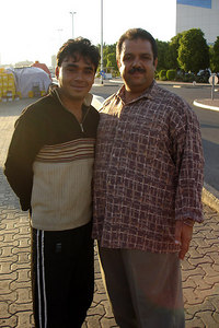 Two random men who wanted me to take their photo.  They really enjoyed seeing their image on the digital camera's screen - Dubai, UAE ... December 4, 2006 ... Photo by Rob Page III