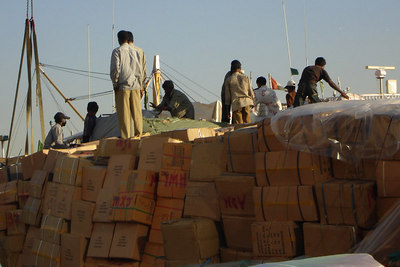 Immigrant workers unloading some of the dhows - Dubai, UAE ... December 4, 2006 ... Photo by Rob Page III