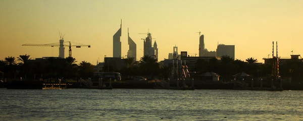 The new Dubai skyline.  The Burj Dubai going up on the left with the Emirates towers in the middle.  I'm not sure what the other construciton is. - Dubai, UAE ... December 4, 2006 ... Photo by Rob Page III