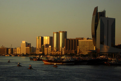 The abras ply the Dubai Creek as modern buildings rise from its banks - Dubai, UAE ... December 4, 2006 ... Photo by Rob Page III