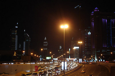 Looking down Sheikh Zayed Road.  Rising on both sides are Dubai's modern skyscrapers.  It is odd because one cannot easily cross from one side of the freeway to the other.  - Dubai, UAE ... December 4, 2006 ... Photo by Rob Page III