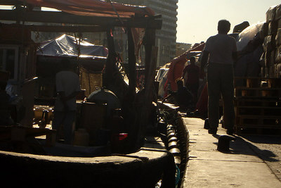 The workers along the creek unloading all the cargo.  Most of these workers were foreigners - Dubai, UAE ... December 4, 2006 ... Photo by Rob Page III
