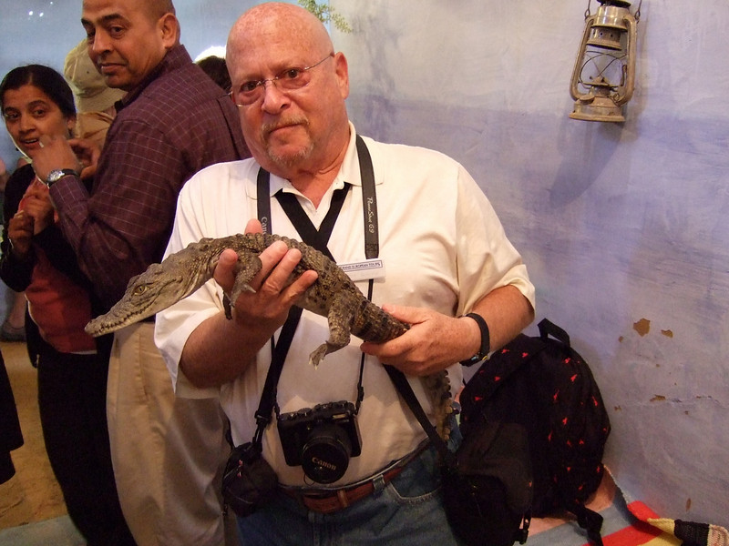 Tourist with a Crocodile in a Nubian Village Home