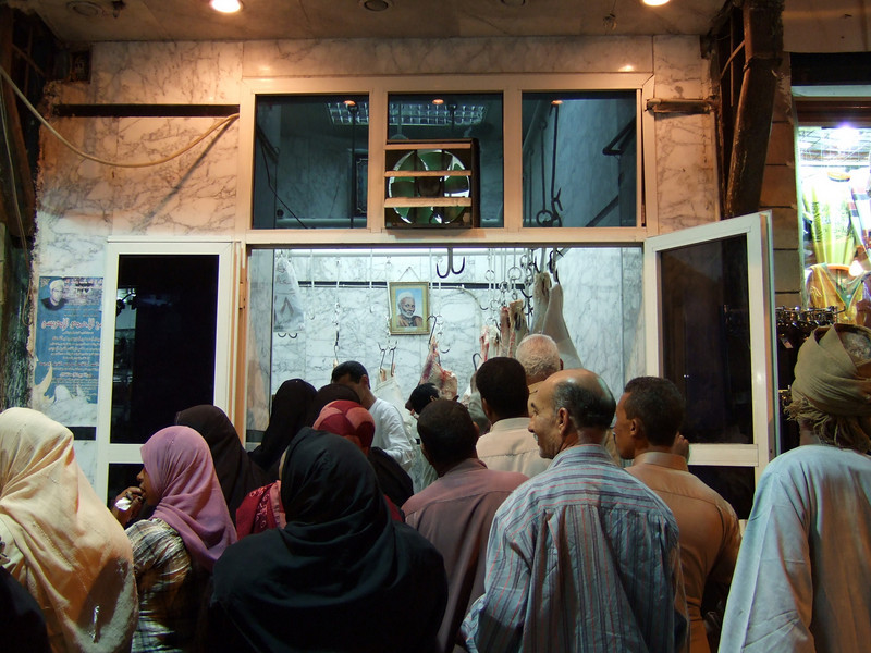 Egyptians lined up to buy meat at a market in the Aswan Bazaar