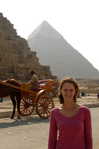 Emily at the base of the Pyramid of Khufu with the Pyramid of Khafre rising in the background - Giza, Egypt ... November 20, 2006 ... Photo by Rob Page III